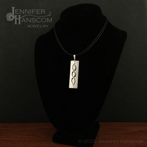 Small Pierced Crossing Paths Pendant - on form 1