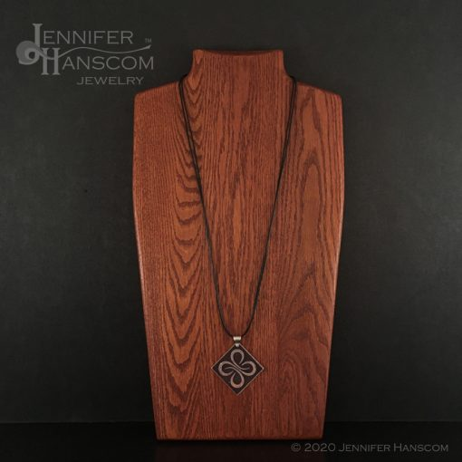 Quality-made long 2-strand leather necklace on form with pendant