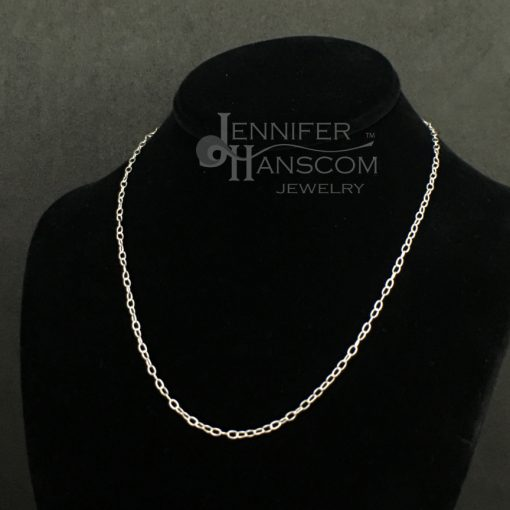 Small silver cable chain necklace on form