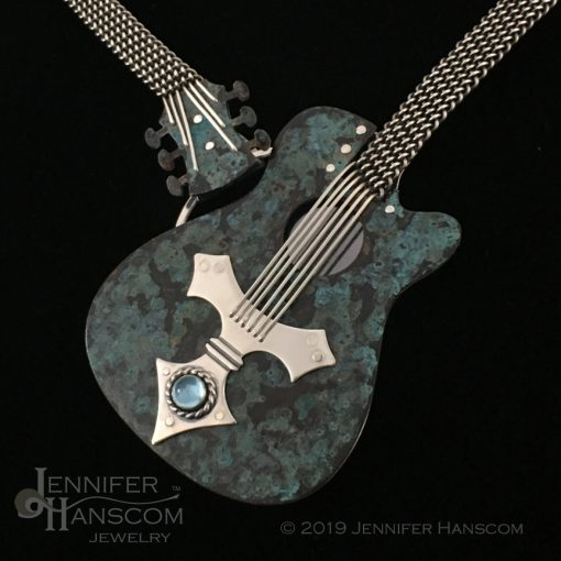 Hand-woven blue guitar necklace close up of guitar body