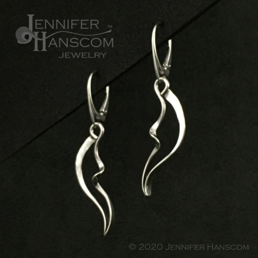profile view of wings and waves earrings