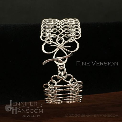 Tri-Flourish Fine Bracelet with Infinity Link Chain - clasp on form