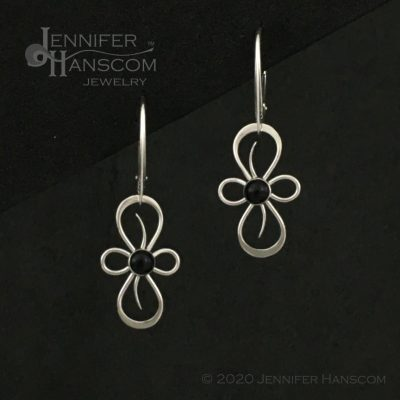 Flourish Earrings on lever-back ear wires with onyx - front view