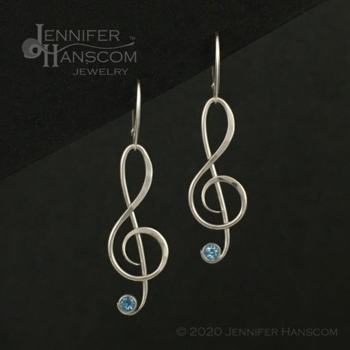 Large G-Clef Earrings on lever-back ear wires with faceted blue topaz - front view