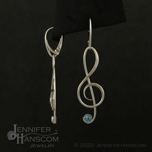 Large G-Clef Earrings on lever-back ear wires with faceted blue topaz - front and side view