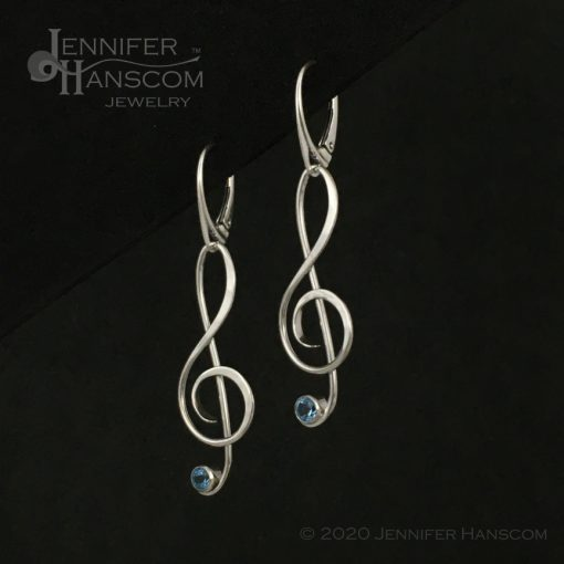 Large G-Clef Earrings on lever-back ear wires with faceted blue topaz - profile view 1
