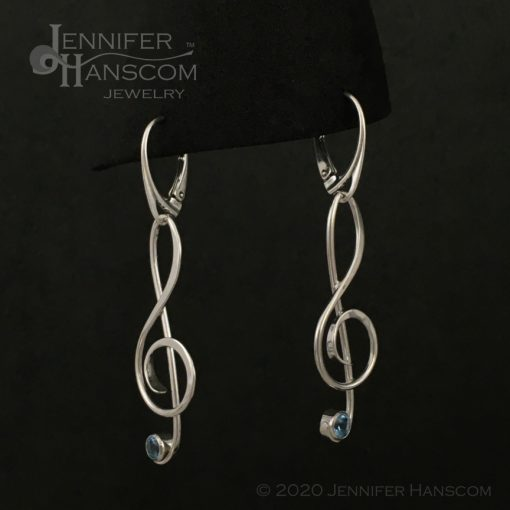 Large G-Clef Earrings on lever-back ear wires with faceted blue topaz - profile view 2
