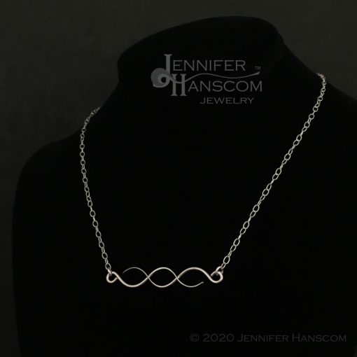 Horizontal Crossing Paths Bar Necklace - on form 2