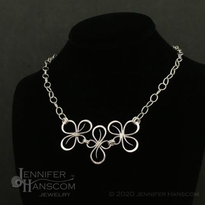 Bold sterling silver Flourish Link Necklace displayed on neck form