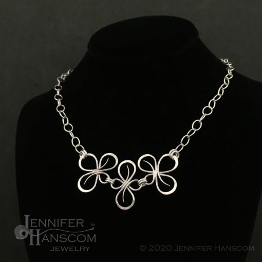 Bold sterling silver Flourish Link Necklace displayed on neck form