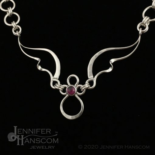 Wings and Waves Angel Necklace with Rhodolite Garnet - close-up profile