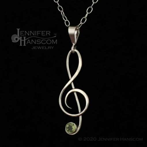Small G-Clef Pendant with Peridot - profile view 1