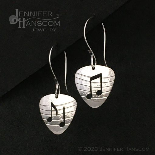 Sterling Silver Guitar Pick Earrings with notes and musical staff on long forged ear wires - profile view 1