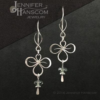 Tri-Flourish Earrings on Balance ear wires with a green amethyst bead dangle- front view