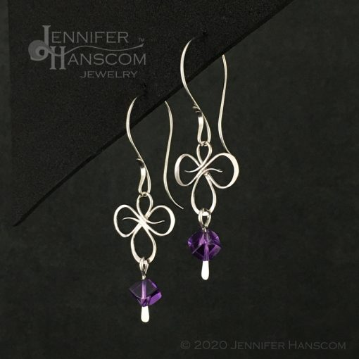 Tri-Flourish Earrings on Long Forged ear wires with an amethyst cube bead dangle - profile view 1
