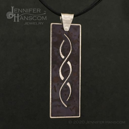Layered Pierced Crossing Paths Pendant with plum tone copper patina - front 1