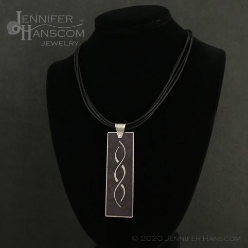 Layered Pierced Crossing Paths Pendant with plum tone copper patina - on form 2