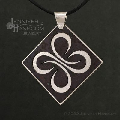 Layered Pierced Quad-Flourish Pendant with plum tone copper patina - front 2