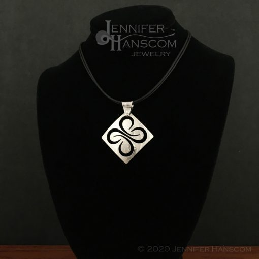 Medium Pierced Quad-Flourish Pendant - on form 1