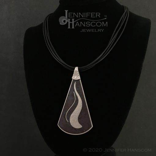 Layered pierced ripple pendant - front view on form