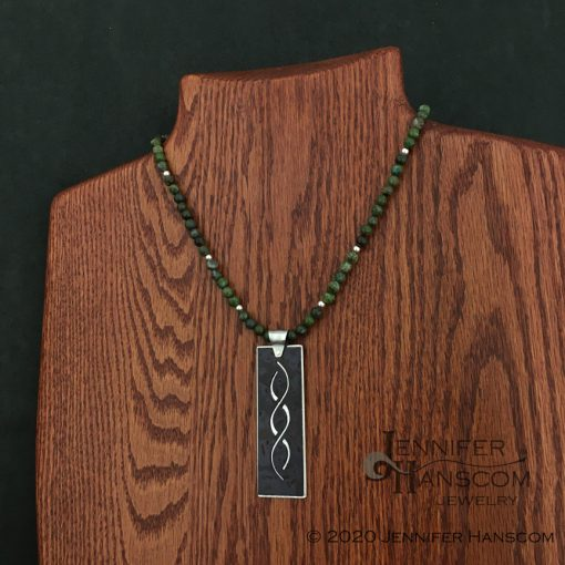 """18"""" 6mm Green Copper Jasper Bead Necklace on form with pendant"""