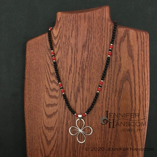 """24"""" 6mm Onyx and Coral Bead Necklace on form with pendant"""