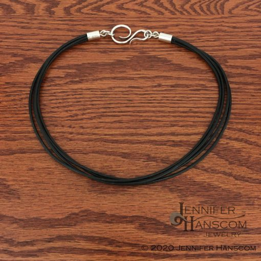 Multi-strand leather necklace laying flat
