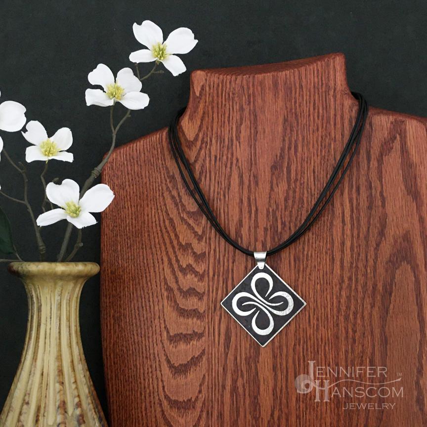 Quadruple Strand Leather Necklace with 2 layer Quad Flourish Pendant