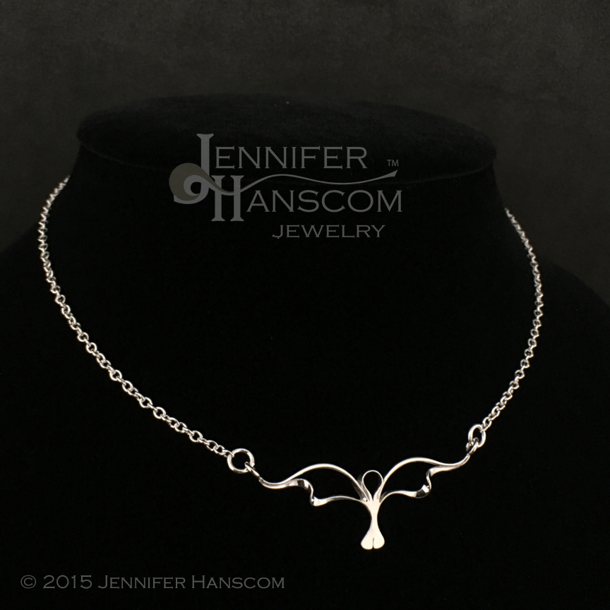 Silver Necklace with Wings and Waves Focal